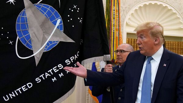 FILE PHOTO: Trump gestures towards the U.S. Space Force flag during its presentation at the White House in Washington - Sputnik International
