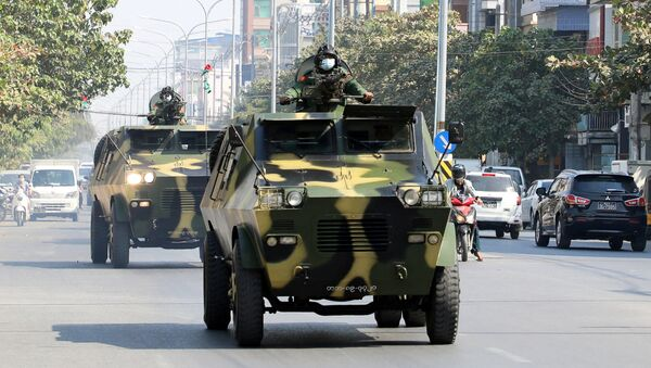 Myanmar Army armored vehicles drive in a street after the military seized power in a coup in Mandalay, Myanmar February 3, 2021. - Sputnik International