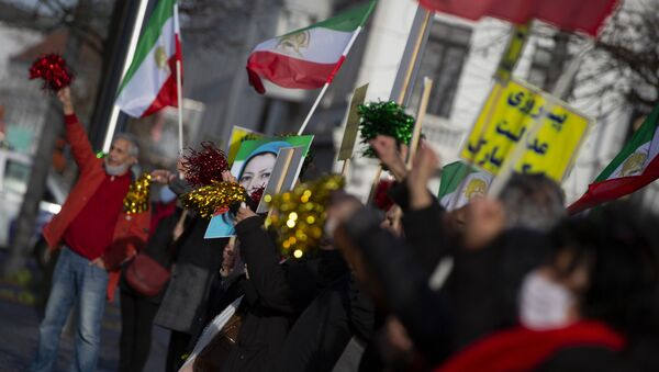 People wave flags and confetti after the trial of four persons, including an Iranian diplomate and Belgian-Iranian couple at the courthouse in Antwerp, Belgium, Thursday, Feb. 4, 2021. - Sputnik International