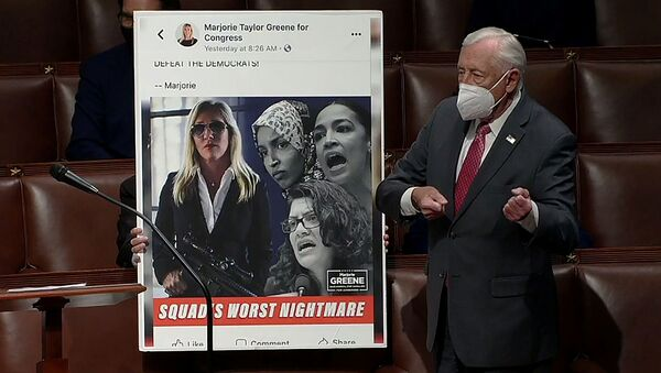 U.S. House Majority Leader Steny Hoyer (D-MD) mimics holding a gun next to an enlarged Tweet as he speaks during debate ahead of a House of Representatives vote on a Democratic-backed resolution that would punish Republican congresswoman Marjorie Taylor Greene, in this frame grab from video shot inside the House Chamber of the Capitol in Washington, U.S., February 4, 2021. - Sputnik International