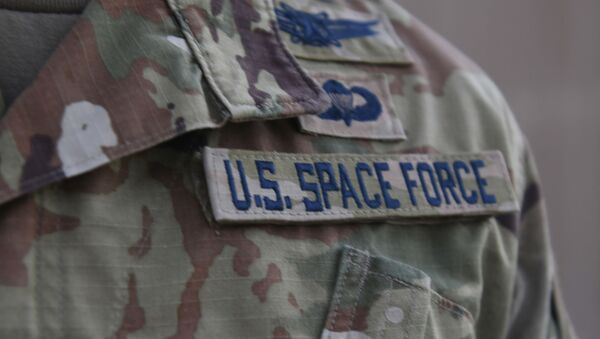 In this photo released by the U.S. Air Force, Capt. Ryan Vickers stands for a photo to display his new service tapes after taking his oath of office to transfer from the U.S. Air Force to the U.S. Space Force at Al-Udeid Air Base, Qatar, Tuesday, Sept. 1, 2020. - Sputnik International