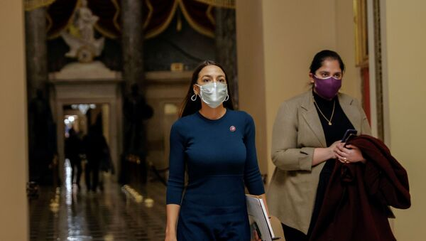 U.S. Rep. Alexandria Ocasio-Cortez (D-NY) walks through the U.S. Capitol - Sputnik International