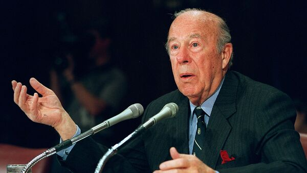In this file photo former US Treasury Secretary and Secretary of State George Shultz testifies before the US Senate Foreign Relations Committee on February 29, 2000 on Capitol Hill in Washington, DC. - Sputnik International