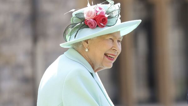 Britain's Queen Elizabeth smiles after awarding Captain Sir Thomas Moore his knighthood during a ceremony at Windsor Castle in Windsor, England, Friday, July 17, 2020. - Sputnik International