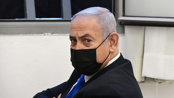 Israeli Prime Minister Benjamin Netanyahu looks on before the start of a hearing in his corruption trial at Jerusalem's District Court, 8 February 2021. - Sputnik International