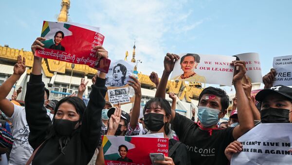 People hold placards depicting elected leader Aung San Suu Kyi during a rally to demand her release and protest against the military coup, in Yangon, Myanmar, February 8, 2021 - Sputnik International