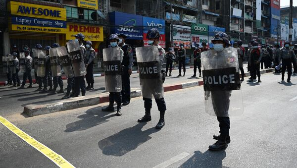 Riot police block a street as protesters gather for a demonstration against the military coup in Yangon on February 6, 2021.  - Sputnik International