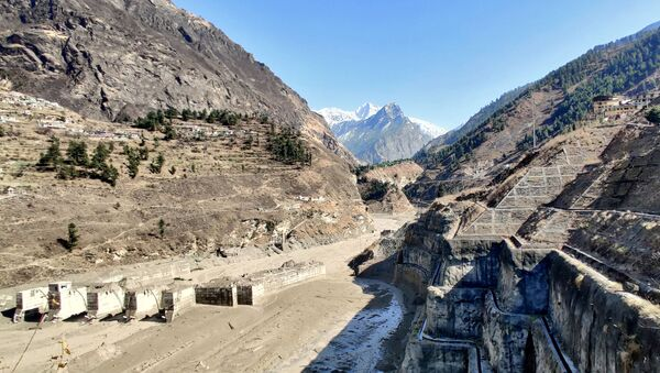 A view shows a damaged barrage after a part of a glacier broke away causing glacial flood in Chormi village in Tapovan, in the northern state of Uttarakhand, India, February 7, 2021. Picture taken February 7, 2021. REUTERS/Stringer NO ARCHIVES. NO RESALES. - Sputnik International