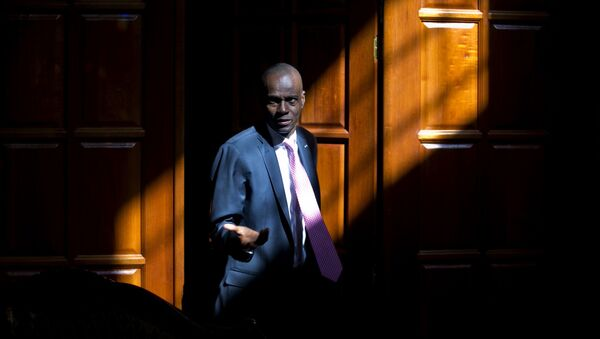 Haiti's President Jovenel Moise arrives for an interview at his home in Petion-Ville, a suburb of Port-au-Prince, Haiti, Friday, Feb. 7, 2020. Moise said Friday that he is optimistic that negotiations with a coalition of his political opponents will succeed in forging a power-sharing deal to end months of deadlock that have left the country without a functioning government. - Sputnik International