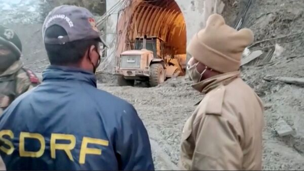 Excavator exits a tunnel in Chamoli, Uttarakhand, India during a rescue operation after a glacier burst, in this still frame taken from video dated February 8, 202 - Sputnik International