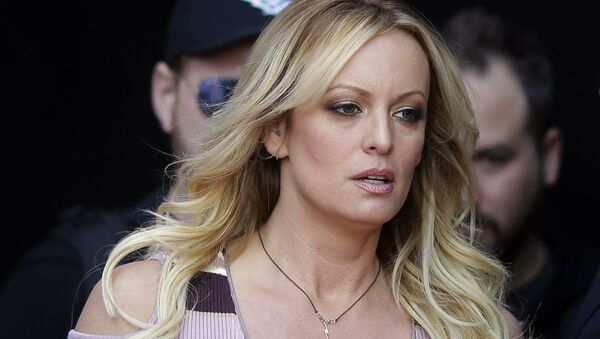 In this Oct. 11, 2018, file photo, adult film actress Stormy Daniels arrives for the opening of the adult entertainment fair Venus in Berlin - Sputnik International