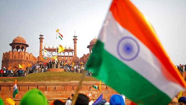 Farmers participate in a protest against farm laws introduced by the government, at the historic Red Fort in Delhi, India, January 26 - Sputnik International