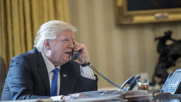 President Donald Trump speaks on the phone with Russian President Vladimir Putin,28 January 2017, in the Oval Office at the White House in Washington - Sputnik International