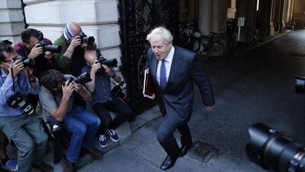 Britain's Prime Minister Boris Johnson walks past media photographers to his office in Downing Street after a cabinet meeting in London, Tuesday, Sept. 15, 2020. - Sputnik International