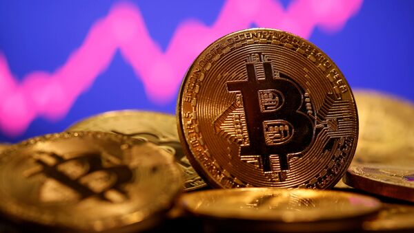 A representation of virtual currency Bitcoin is seen in front of a stock graph in this illustration taken 8 January 2021. REUTERS/Dado Ruvic/File Photo - Sputnik International