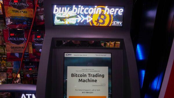 A Bitcoin ATM is pictured in a bodega in the Manhattan borough of New York City, New York, U.S., February  9, 2021. REUTERS/Carlo Allegri - Sputnik International