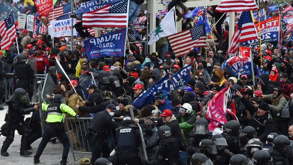 In this file photo taken on January 06, 2021 Trump supporters clash with police and security forces as they push barricades to storm the US Capitol in Washington D.C. - Impeachment prosecutors aired terrifying, never-before-seen footage of senior US politicians fleeing for their lives during the January assault on Congress by Donald Trump supporters on day two of the former president's Senate trial. With painstaking, graphic presentations, Democratic impeachment managers walked senators through hours of video, some of which came from security cameras and police bodycams and was being aired for the first time. - Sputnik International