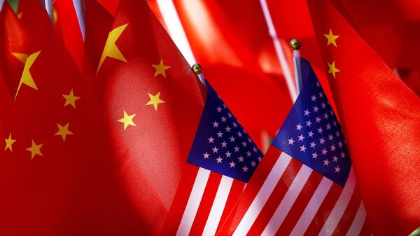 """In this Sept. 16, 2018, file photo, American flags are displayed together with Chinese flags on top of a trishaw in Beijing. China says Friday, Aug. 14, 2020, the United States is trying to """"demonize and stigmatize"""" bilateral its foreign relations, in a scathing attack on the Trump administration's designation of the Confucius Institute U.S. Center as a foreign mission of the Chinese Communist Party. - Sputnik International"""
