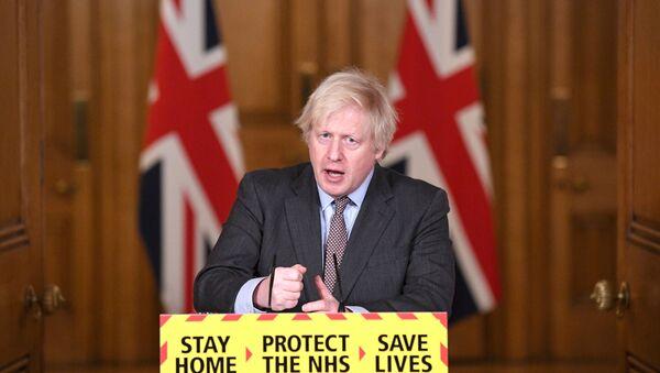 Britain's Prime Minister Boris Johnson addressees the media at a coronavirus disease (COVID-19) pandemic briefing in Downing Street, London, Britain February 3, 2021.  - Sputnik International