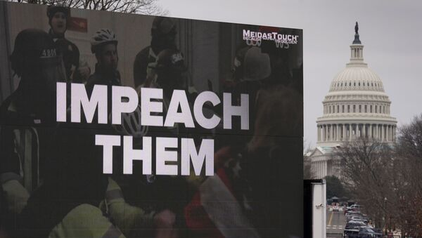 A video screen affixed to a truck flashes an anti-Trump message near the U.S. Capitol during former U.S President Donald Trump's second impeachment trial in Washington, U.S., February 12, 2021 - Sputnik International