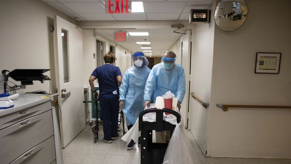 CVS Pharmacists bring the COVID-19 vaccine for the nursing home residents at Harlem Center for Nursing and Rehabilitation, a nursing home facility, on Friday, Jan. 15, 2021 in Harlem neighborhood of New York. (AP Photo/Yuki Iwamura) - Sputnik International
