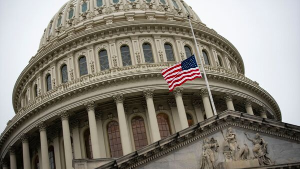 The American flag flies at half staff at the U.S. Capitol Building on the fifth day of the impeachment trial of former U.S. President Donald Trump, on charges of inciting the deadly attack on the U.S. Capitol, in Washington, U.S., February 13, 2021. - Sputnik International
