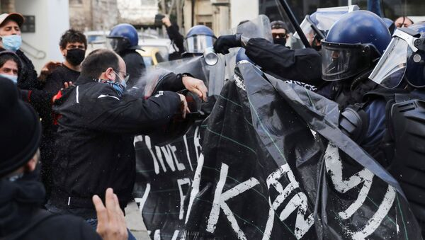 Protesters and activists clash with riot police during a rally against corruption and COVID-19 restriction measures, in Nicosia, Cyprus February 13, 2021 - Sputnik International