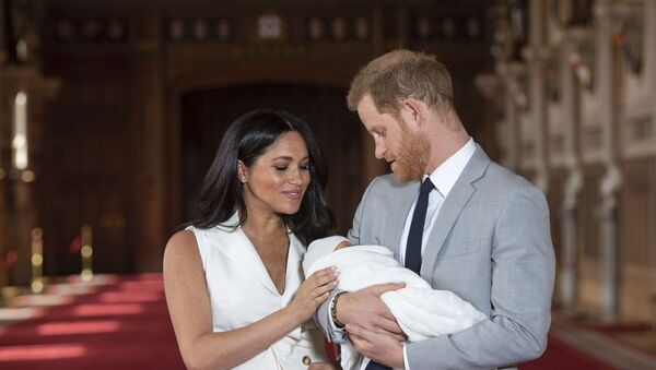 In this Wednesday May 8, 2019 file photo Britain's Prince Harry and Meghan, Duchess of Sussex, pose during a photocall with their newborn son Archie, in St George's Hall at Windsor Castle, Windsor, south England. The Duchess of Sussex has revealed that she had a miscarriage in July. Meghan described the experience in an opinion piece in the New York Times on Wednesday. She wrote: I knew, as I clutched my firstborn child, that I was losing my second. The former Meghan Markle and husband Prince Harry have a son, Archie, born in 2019.  - Sputnik International