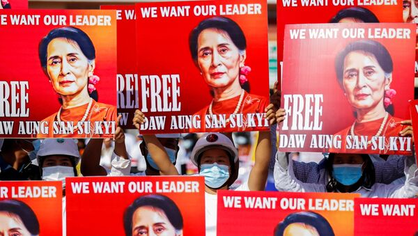Demonstrators hold placards with the image of Aung San Suu Kyi during a protest against the military coup, in Naypyitaw, Myanmar, February 15, 2021.  - Sputnik International