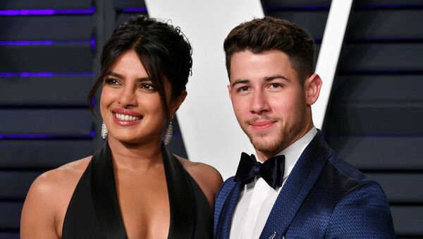 BEVERLY HILLS, CA - FEBRUARY 24: Priyanka Chopra (L) and Nick Jonas attend the 2019 Vanity Fair Oscar Party hosted by Radhika Jones at Wallis Annenberg Center for the Performing Arts on February 24, 2019 in Beverly Hills, California.  - Sputnik International