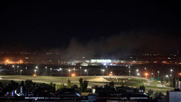 Smoke rises over the Erbil, after reports of mortar shells landing near Erbil airport, Iraq February 15, 2021. - Sputnik International