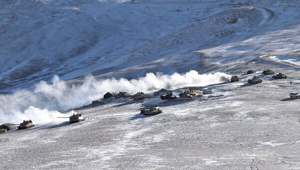 In this photograph provided by the Indian Army, tanks pull back from the banks of the Pangong Tso lake region, in Ladakh along the India-China border on Wednesday, 10 February 2021.  - Sputnik International