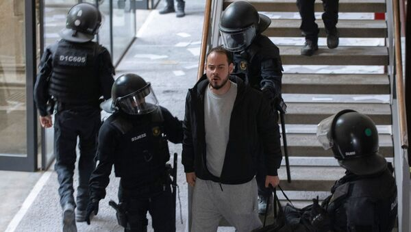 Spanish rapper Pablo Hasel reacts as he is detained by riot police inside the University of Lleida, after he was sentenced to jail time on charges including insulting the monarchy and glorifying terrorism, in Lleida, Spain February 16, 2021. - Sputnik International
