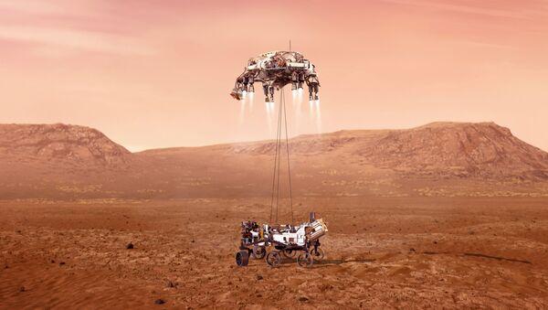 This illustration provided by NASA shows the Perseverance rover, bottom, landing on Mars. - Sputnik International