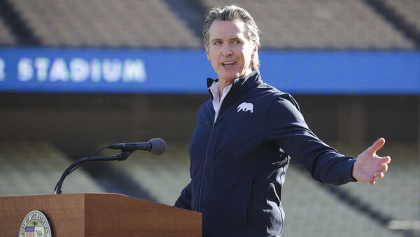 Governor Gavin Newsom addresses a press conference held at the launch of a mass COVID-19 vaccination site at Dodger Stadium on Friday, Jan. 15, 2021, in Los Angeles - Sputnik International