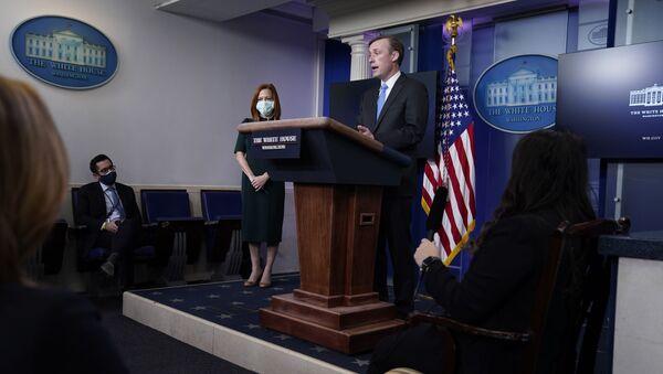 White House press secretary Jen Psaki listens as National security adviser Jake Sullivan speaks during a press briefing at the White House, Thursday, Feb. 4, 2021, in Washington. - Sputnik International