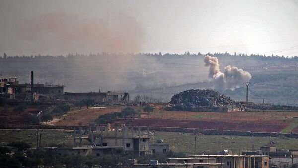Smoke billows following reported shelling by government forces on the northwestern Syrian town of Barah, in the rebel held Idlib province on February 12, 2021. - Sputnik International