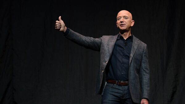Founder, Chairman, CEO and President of Amazon Jeff Bezos gives a thumbs up as he speaks during an event about Blue Origin's space exploration plans in Washington, U.S., May 9, 2019. - Sputnik International