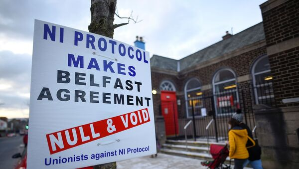 A sign is seen with a message against the Brexit border checks in relation to the Northern Ireland protocol in Larne, Northern Ireland February 12, 2021 - Sputnik International