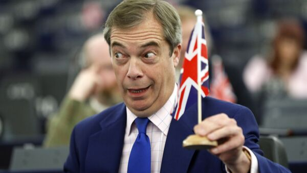 In this Wednesday, March 13, 2019 file photo, former U.K. Independence Party (UKIP) leader and member of the European Parliament Nigel Farage holds a U.K. flag during a plenary session at the European Parliament in Strasbourg, eastern France.  - Sputnik International