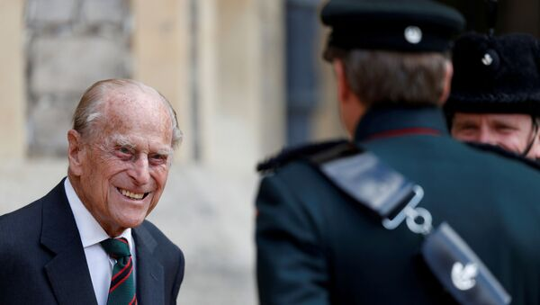 Britain's Prince Philip speaks to Assistant Colonel Commandant, Major General Tom Copinger-Symes during the transfer of the Colonel-in-Chief of the Rifles at Windsor Castle in Britain July 22, 2020 - Sputnik International