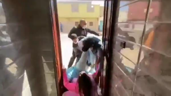 Plainclothes Moroccan security forces drag Elwaara Khaya, sister of Saharawi human rights activist Sultana Khaya, from their home in Bojador, Western Sahara, on February 13, 2021. - Sputnik International