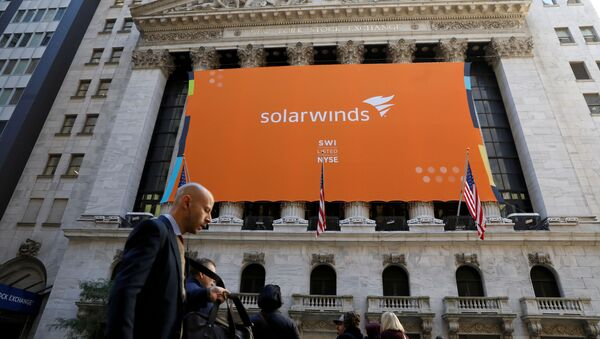 SolarWinds Corp. banner hangs at the New York Stock Exchange (NYSE) on the IPO day of the company in New York, U.S., October 19, 2018. - Sputnik International