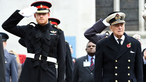 Britain's Prince Harry (L) salutes as he stands alongside his grandfather Britain's Prince Philip, Duke of Edinburgh, during their visit to the Field of Remembrance at Westminster Abbey in central London on November 10, 2016. - Sputnik International