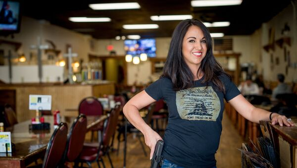 In this file photo owner Lauren Boebert poses for a portrait at Shooters Grill in Rifle, Colorado on April 24, 2018. - A Republican member of the US Congress raised eyebrows on February 18, 2021 when she appeared at a Zoom committee meeting with an arsenal of guns strategically displayed in her background. - Sputnik International
