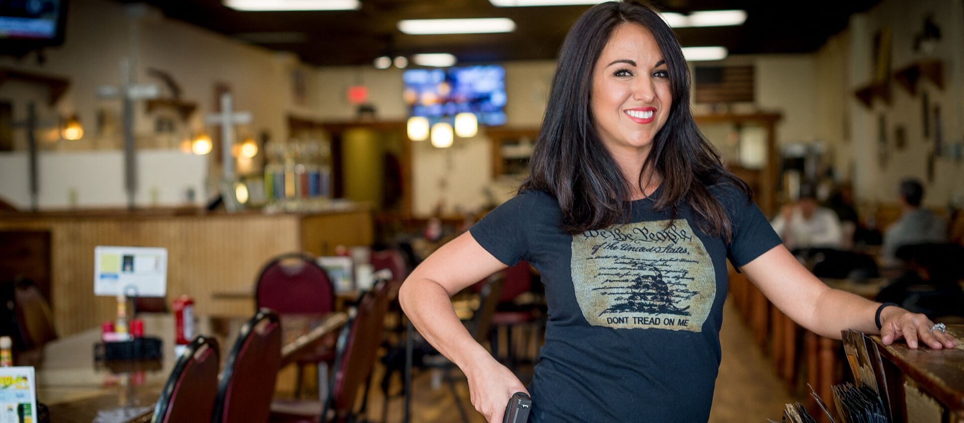 In this file photo owner Lauren Boebert poses for a portrait at Shooters Grill in Rifle, Colorado on April 24, 2018. - A Republican member of the US Congress raised eyebrows on February 18, 2021 when she appeared at a Zoom committee meeting with an arsenal of guns strategically displayed in her background. - Sputnik International, 1920, 19.02.2021