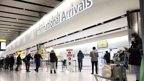 Travellers stand at Terminal 2 of Heathrow Airport, amid the coronavirus disease (COVID-19) outbreak in London, Britain February 14, 2021 - Sputnik International