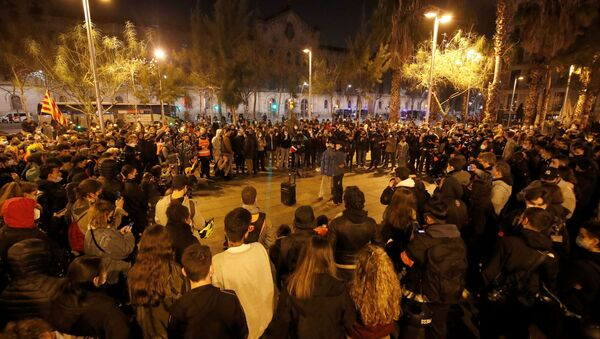 People sing during a protest in support of Catalan rapper Pablo Hasel, after he was given a jail sentence on charges of glorifying terrorism and insulting royalty in his songs, in Barcelona, Spain, February 19, 2021. - Sputnik International