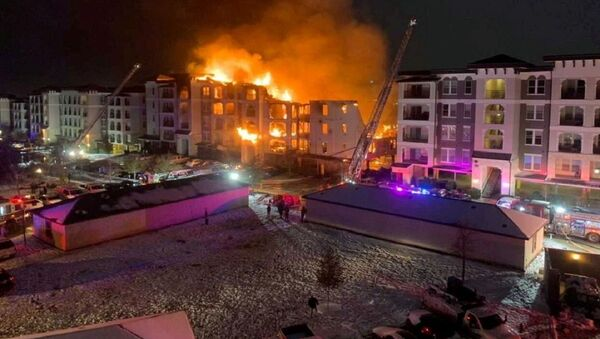 A general view of an apartment building engulfed in flames in San Antonio, Texas, U.S. February 18, 2021 in this picture obtained from social media - Sputnik International