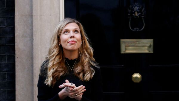 FILE PHOTO: Britain's Prime Minister Boris Johnson partner Carrie Symonds reacts outside 10 Downing Street during the Clap for our Carers campaign in support of the NHS, following the outbreak of the coronavirus disease (COVID-19), London, Britain, May 14, 2020.  - Sputnik International